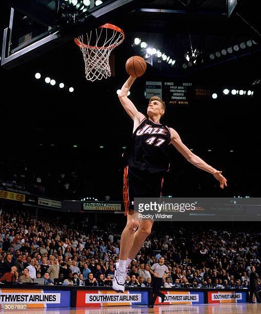 Andrei Kirilenko of the Utah Jazz dunks the ball during the game against the Sacramento Kings at Arco Arena on February 27 2004 in Sacramento...