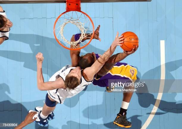 Andrei Kirilenko of the Utah Jazz tries to block Kobe Bryant of the Los Angeles Lakers on February 26, 2007 at the EnergySolutions Arena in Salt Lake...