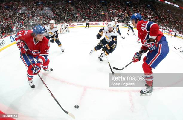 Andrei Kostitsyn and Maxim Lapierre of the Montreal Canadiens cycle the puck against Andrej Sekera and Clarke MacArthur of the Buffalo Sabres at the...