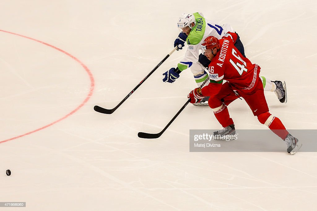 Andrei Kostitsyn (R) of Belarus and Andrej Tavzlej (L) of Slovenia battle for the puck during the IIHF World Championship group B match between Belarus and Slovenia at CEZ Arena on May 2, 2015 in Ostrava, Czech Republic.