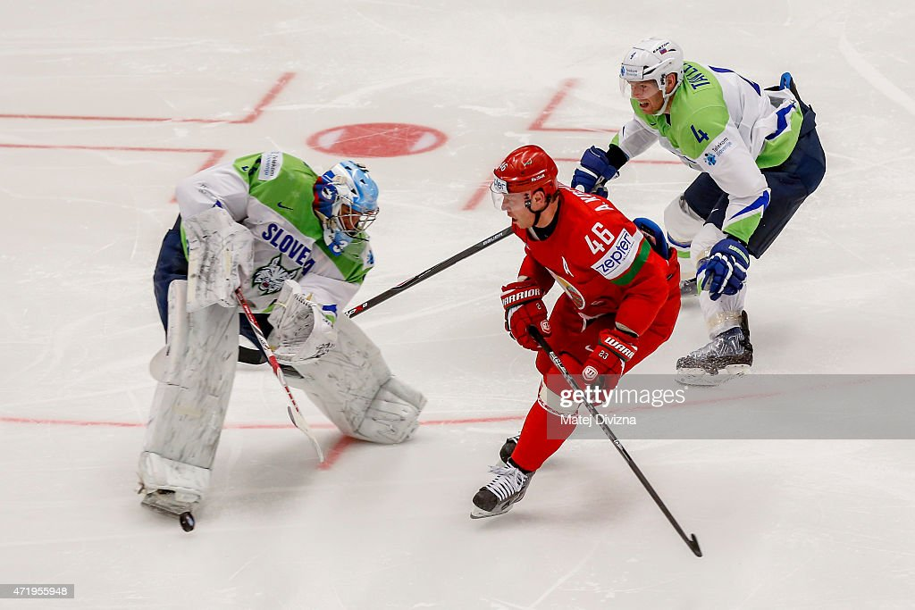 Andrei Kostitsyn (C) of Belarus and Robert Kristian (L), goalkeeper of Slovenia, battle for the puck during the IIHF World Championship group B match between Belarus and Slovenia at CEZ Arena on May 2, 2015 in Ostrava, Czech Republic.