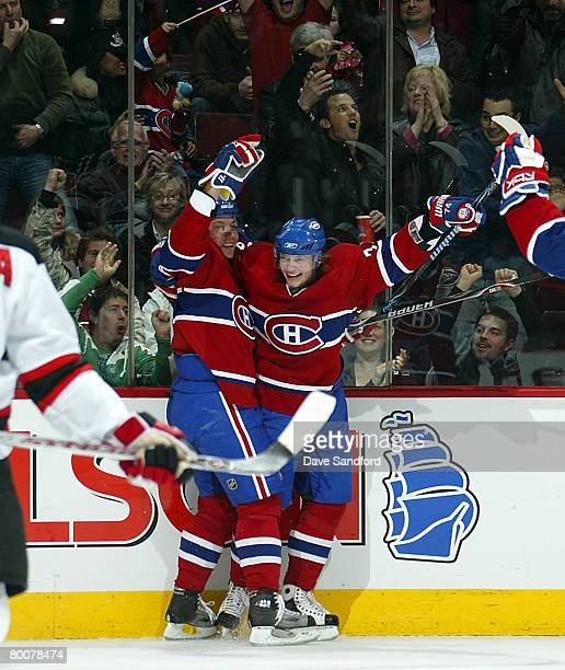 Andrei Kostitsyn of the Montreal Canadiens celebrates his game winning goal against the New Jersey Devils with brother Sergei Kostitsyn during their...