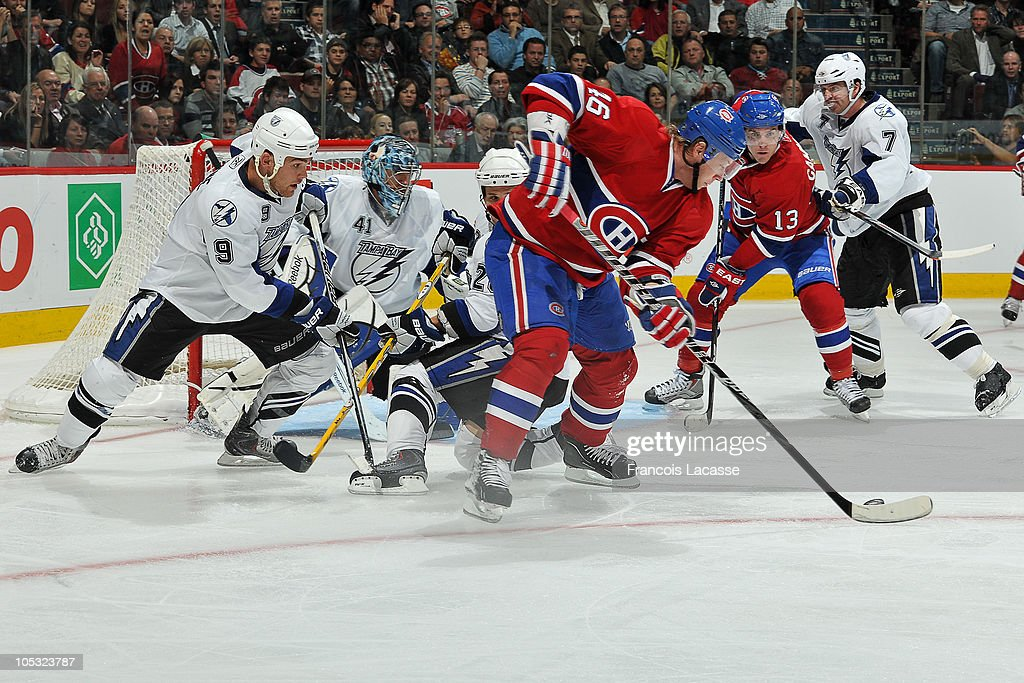 Andrei Kostitsyn #46 of the Montreal Canadiens handles the puck in front of the goal during the NHL game on October 13, 2010 at the Bell Centre in Montreal, Quebec, Canada.