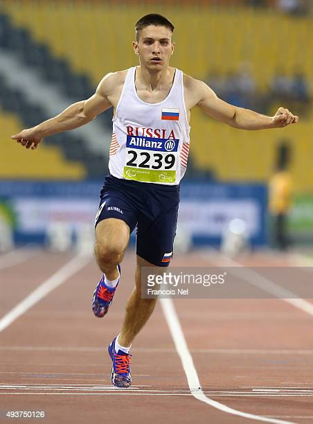 Andrei Kuzmin of Russia in action during the Men's 100m T12 heats during the Evening Session on Day One of the IPC Athletics World Championships at...
