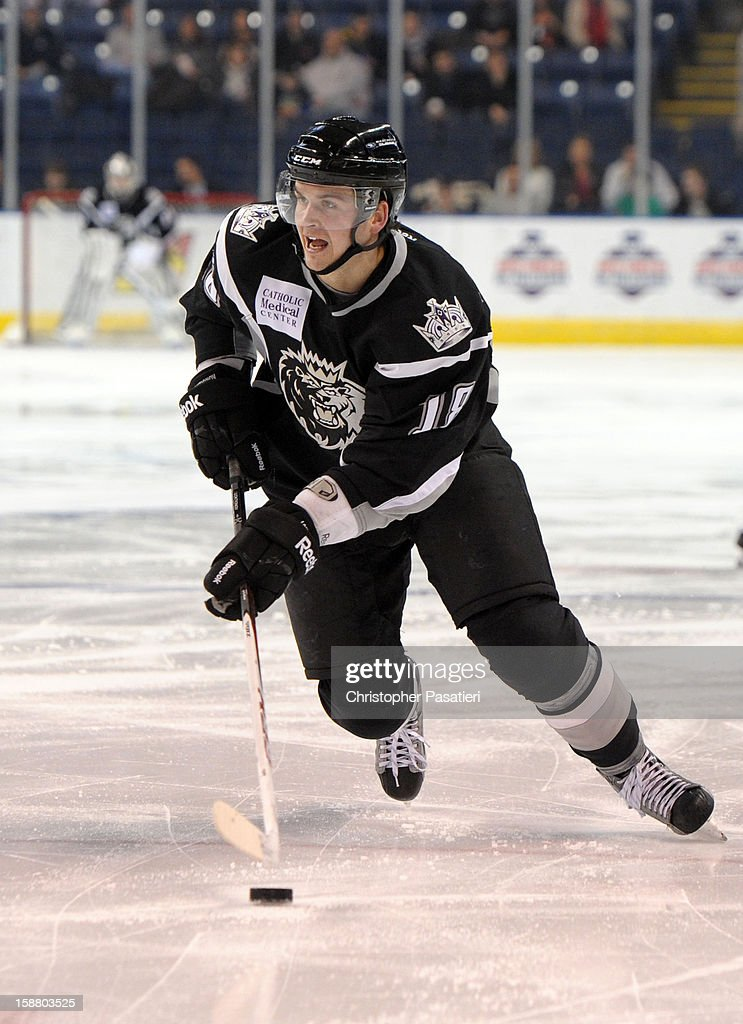 Andrei Loktionov #18 of the Manchester Monarchs controls the puck during an American Hockey League game against the Bridgeport Sound Tigers on December 29, 2012 at the Webster Bank Arena at Harbor Yard in Bridgeport, Connecticut.