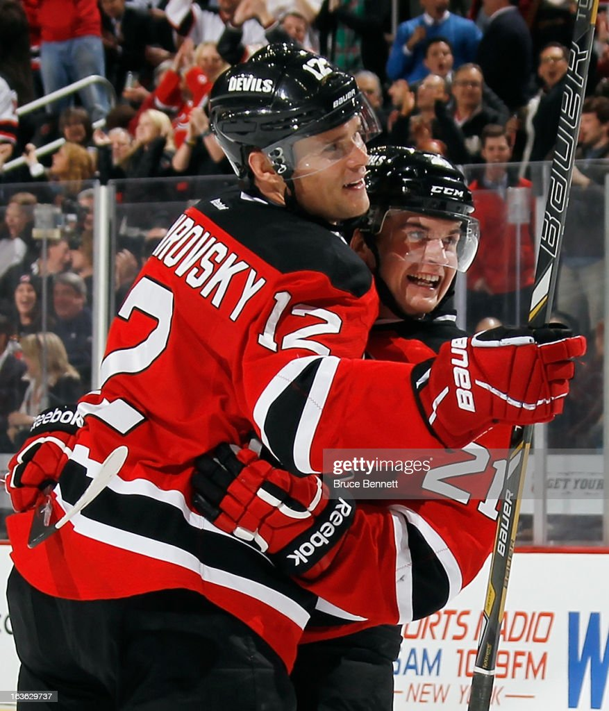 Andrei Loktionov #21 of the New Jersey Devils celebrates his goal against the Philadelphia Flyers along with Alexei Ponikarovsky #12 at 6:31 of the second period at the Prudential Center on March 13, 2013 in Newark, New Jersey.