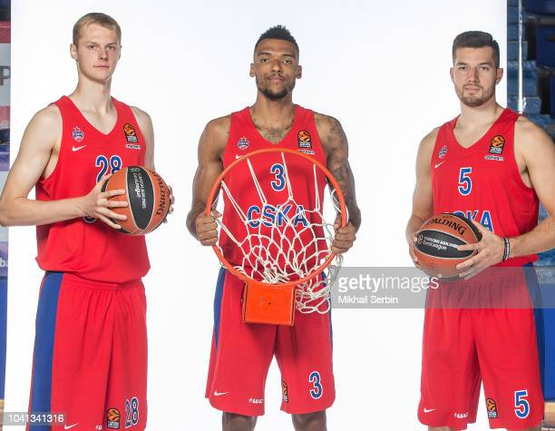 Andrei Lopatin #28 Joel Bolomboy #3 and Alec Peters #5 poses during the CSKA Moscow 2018/2019 Turkish Airlines EuroLeague Media Day at Megasport...