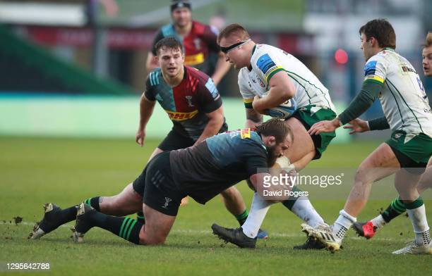 Andrei Mahu of London Irish is tackled by Joe Marler during the Gallagher Premiership Rugby match between Harlequins and London Irish at Twickenham...