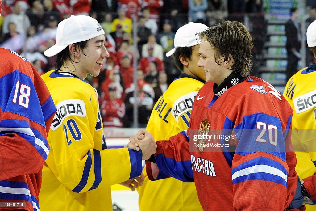 Andrei Makarov #20 of Team Russia shakes hand with Mika Zibanejad #20 of Team Sweden after Team Sweden defeated Team Russia in overtime at the 2012 World Junior Hockey Championship Gold Medal game at the Scotiabank Saddledome on January 5, 2012 in Calgary, Alberta, Canada. Team Sweden defeated Team Russia 1-0 in overtime.