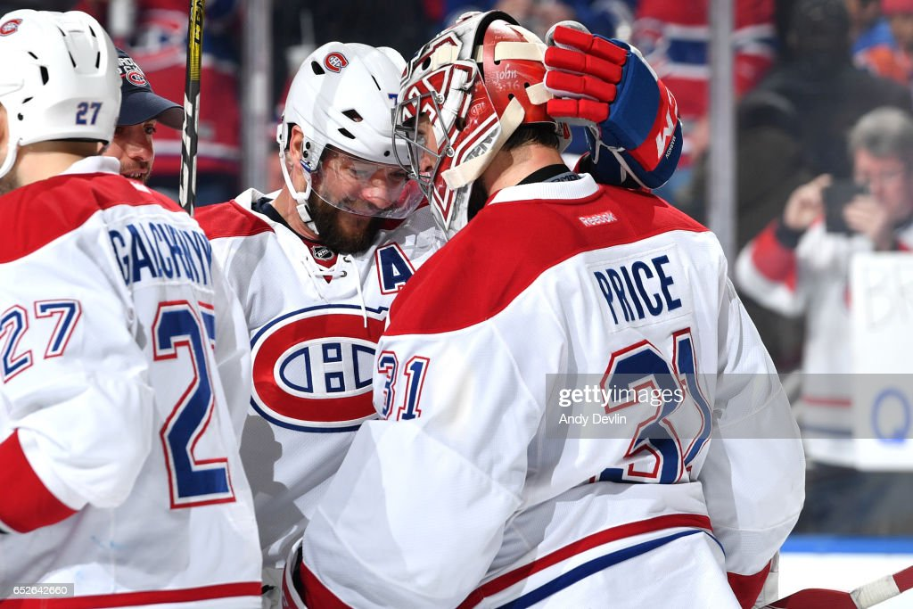 Andrei Markov #79 and Carey Price #31 of the Montreal Canadiens celebrate after winning the game against the Edmonton Oilers on March 12, 2017 at Rogers Place in Edmonton, Alberta, Canada.