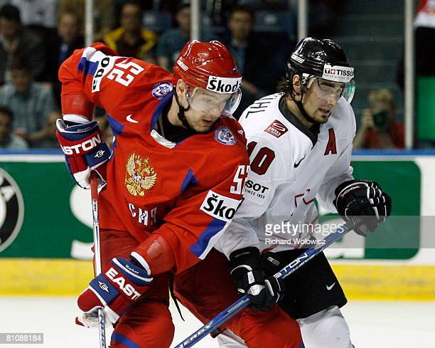 Andrei Markov of Russia battles for position with Andres Ambuhl of Switzerland during the IIHF World Ice Hockey Championship quarter-final game at...