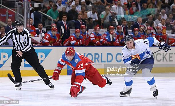 Andrei Markov of Team Russia falls to the ice with Leo Komarov of Team Finland chasing during the World Cup of Hockey 2016 at Air Canada Centre on...