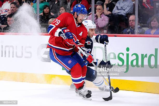 Andrei Markov of the Montreal Canadiens and Chris Thorburn of the Winnipeg Jets chase the puck into the corner during the NHL game at the Bell Centre...