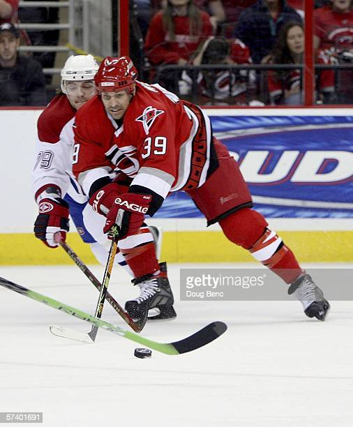 Andrei Markov of the Montreal Canadiens battles for the puck with Doug Weight of the Carolina Hurricanes in game one of the Eastern Conference...
