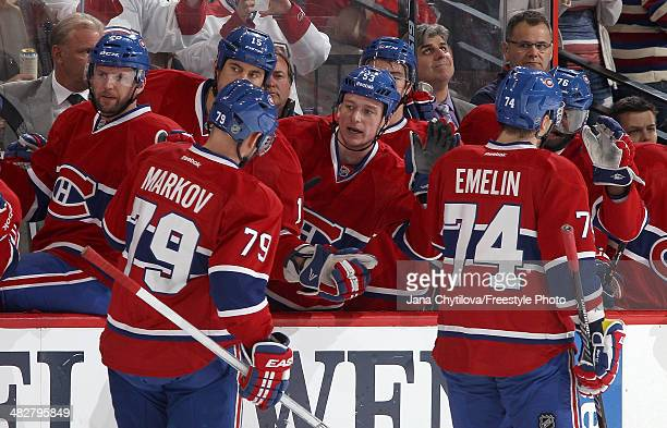 Andrei Markov of the Montreal Canadiens celebrates his first period goal against the Ottawa Senators with team mates Thomas Vanek George Parros...