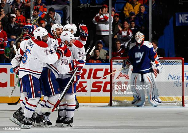 Andrei Markov of the Montreal Canadiens celebrates with teammates after scoring a second period goal against the New York Islanders at Nassau...