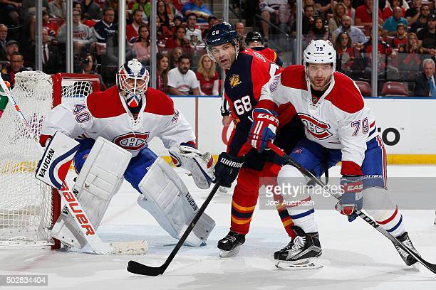 Andrei Markov of the Montreal Canadiens defends against Jaromir Jagr of the Florida Panthers in front of Goaltender Ben Scrivens at the BBT Center on...
