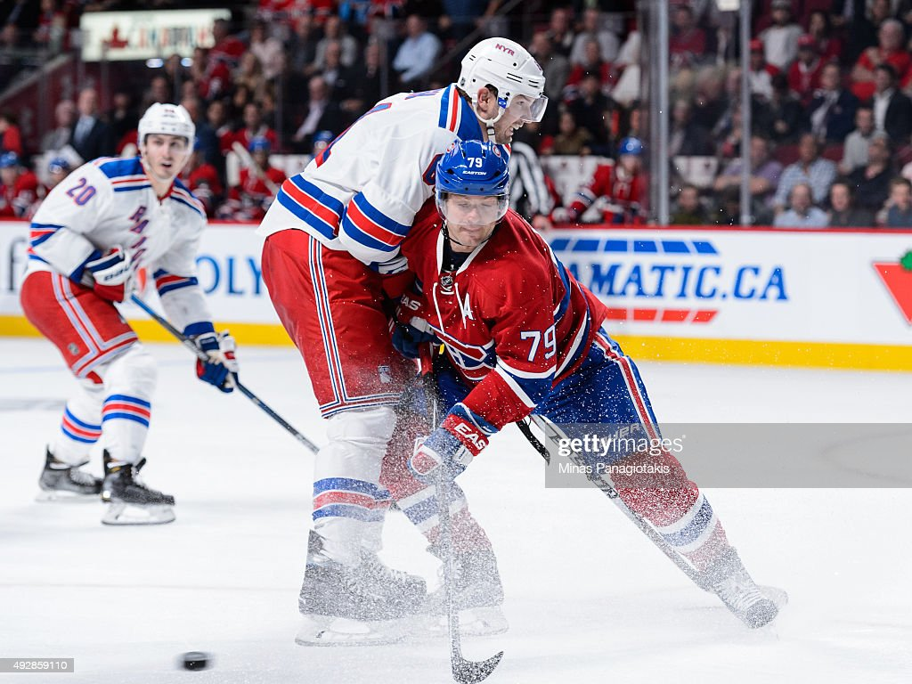 Andrei Markov #79 of the Montreal Canadiens defends against Rick Nash #61 of the New York Rangers during the NHL game at the Bell Centre on October 15, 2015 in Montreal, Quebec, Canada. The Canadiens defeated the Rangers 3-0 and for the first time in franchise history, the Canadiens have won five games in a row to start the season.