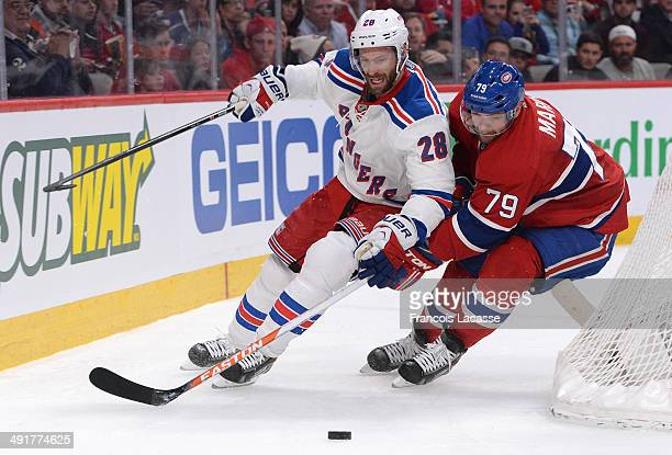 Andrei Markov of the Montreal Canadiens fights for the puck against Dominic Moore of the New York Rangers in Game One of the Eastern Conference Final...
