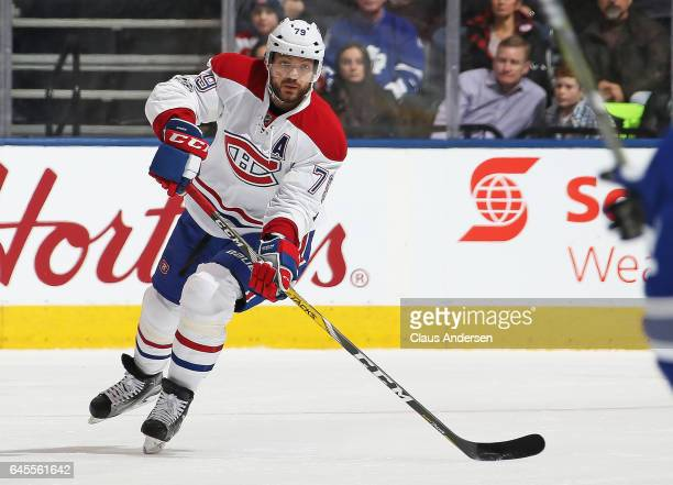 Andrei Markov of the Montreal Canadiens fires a pass up ice against the Toronto Maple Leafs during an NHL game at the Air Canada Centre on February...