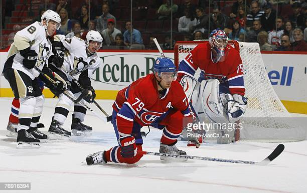 Andrei Markov of the Montreal Canadiens helps defend in front of goaltender Yann Danis as Mark Recchi and Sidney Crosby of the Pittsburgh Penguins...