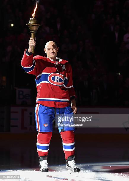 Andrei Markov of the Montreal Canadiens holds the flame during the pre game ceremony prior to the NHL game against the New York Rangers at the Bell...