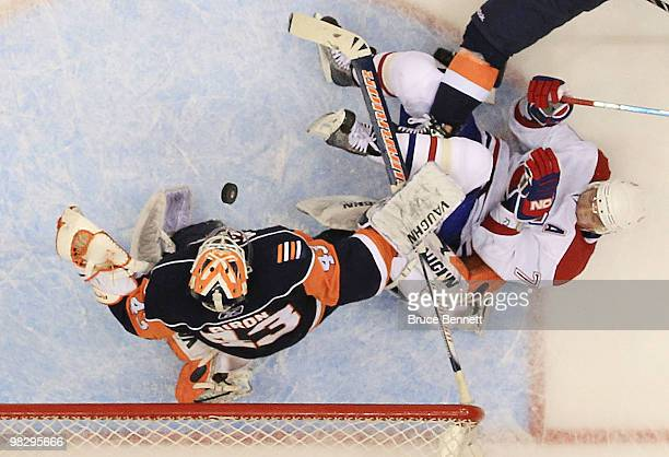 Andrei Markov of the Montreal Canadiens is knocked down in the crease as Martin Biron of the New York Islanders comes up with the puck at Nassau...