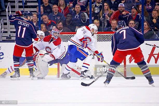 Andrei Markov of the Montreal Canadiens is unable to stop the puck as a shot from Josh Anderson of the Columbus Blue Jackets gets past Al Montoya of...