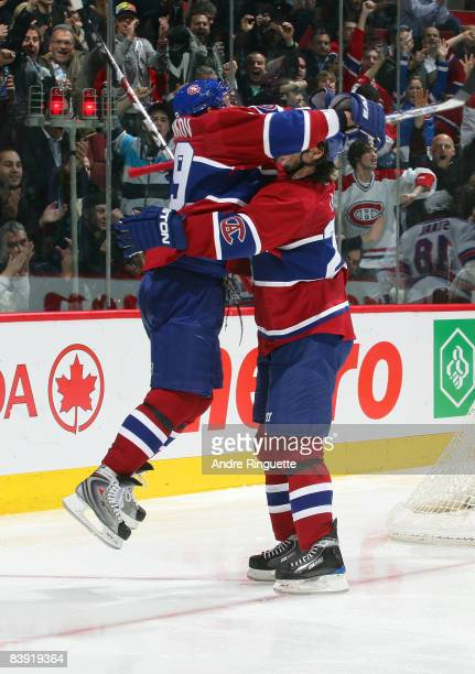 Andrei Markov of the Montreal Canadiens jumps into the arms of Robert Lang of the Montreal Canadiens to celebrate a third period goal against the New...