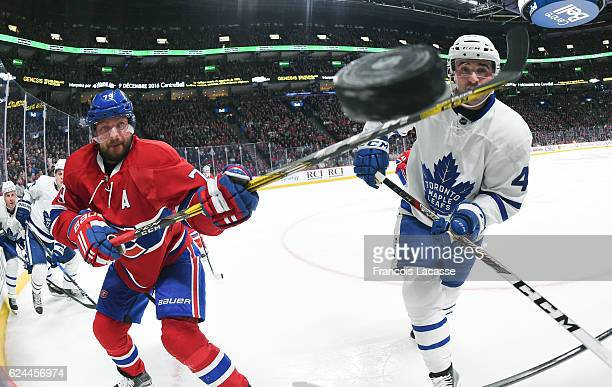 Andrei Markov of the Montreal Canadiens Nazem Kadri of the Toronto Maple Leafs fight for the puck in the NHL game at the Bell Centre on November 19...