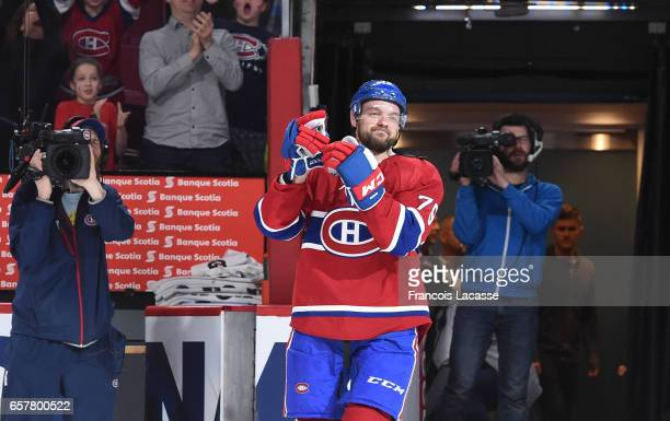 Andrei Markov of the Montreal Canadiens salutes the crowd after being named the first star of the game against the Ottawa Senators at the Bell Centre...