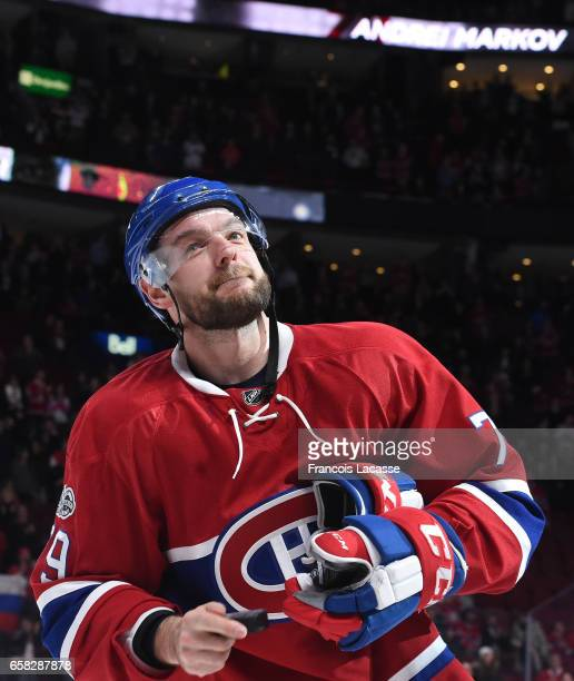 Andrei Markov of the Montreal Canadiens salutes the crowd after being named the first star of the game during the NHL game against the Ottawa...