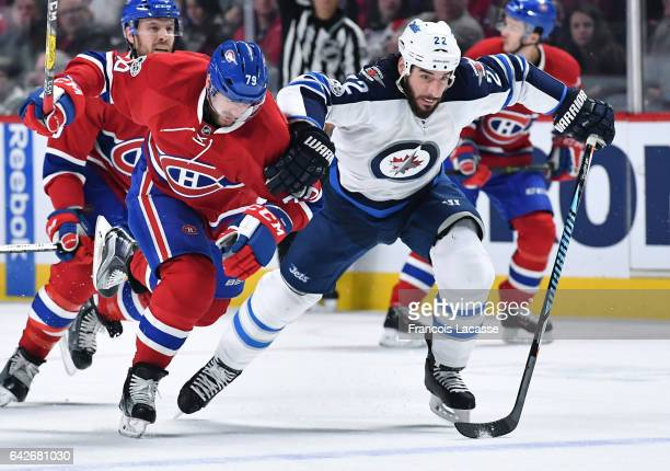 Andrei Markov of the Montreal Canadiens skates against Chris Thorburn of the Winnipeg Jets in the NHL game at the Bell Centre on February 18 2017 in...