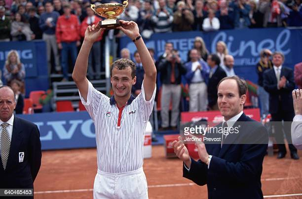 Andrei Medvedev lifts the winner's trophy at the Monte Carlo tennis tournament Prince Albert of Monaco