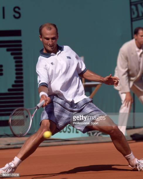 Andrei Medvedev of Ukraine in action against Andre Agassi of the USA during the Men's Singles Final of the French Open Tennis Championships at the...