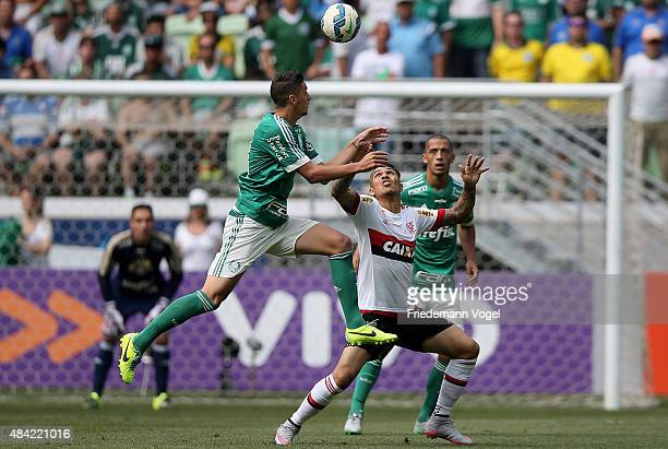 Andrei of Palmeiras fights for the ball with Guerrero of Flamengo during the match between Palmeiras and Flamengo for the Brazilian Series A 2015 at...