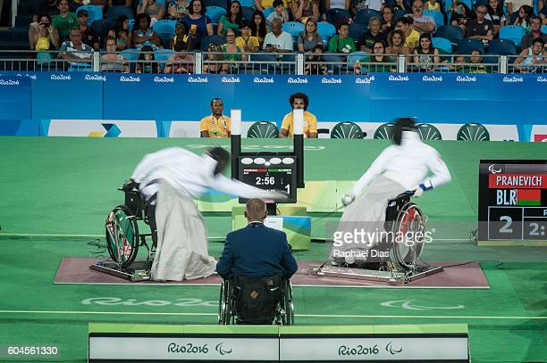 Andrei Pranevich of Belarus battles Ammar Ali of Iraq in the final of Wheelchair Fencing Mens Ind Epee Category B on day 6 of the Rio 2016 Paralympic...