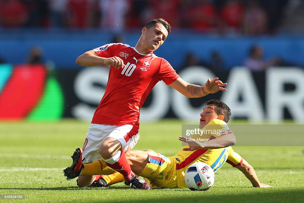 Andrei Prepelita of Romania makes a challenge on Granit Xhaka of Switzerland during the UEFA EURO 2016 Group A match between Romania and Switzerland at Parc des Princes on June 15, 2016 in Paris, France.