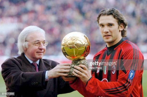 Andrei Shevchenko of AC Milan is presented with the trophy after winning the European Golden Ball award 2004 before the Serie A Match between Milan...