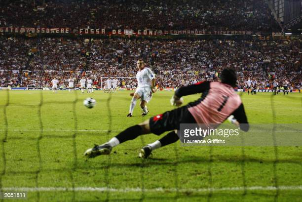 Andrei Shevchenko of AC Milan scores the winning penalty during the UEFA Champions League Final match between Juventus FC and AC Milan on May 28 2003...