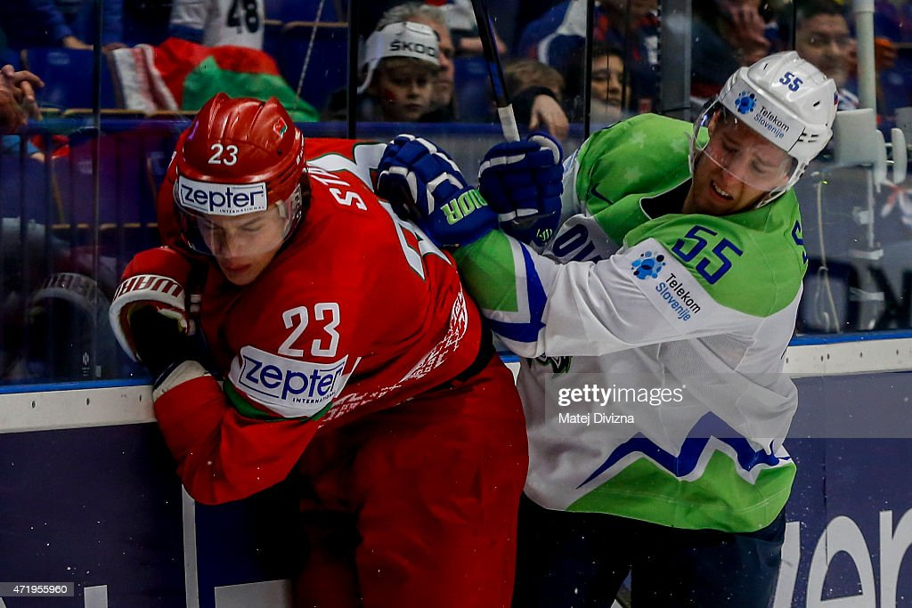 Andrei Stas (L) of Belarus and Robert Sabolic (R) of Slovenia battle during the IIHF World Championship group B match between Belarus and Slovenia at CEZ Arena on May 2, 2015 in Ostrava, Czech Republic.