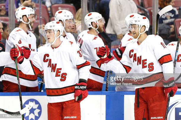 Andrei Svechnikov and Dougie Hamilton of the Carolina Hurricanes celebrate with teammates after a goal against the Florida Panthers during the first...