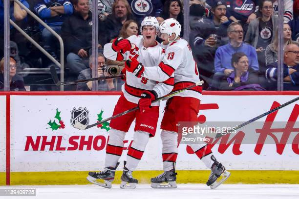 Andrei Svechnikov and Warren Foegele of the Carolina Hurricanes celebrate a second period goal against the Winnipeg Jets at the Bell MTS Place on...