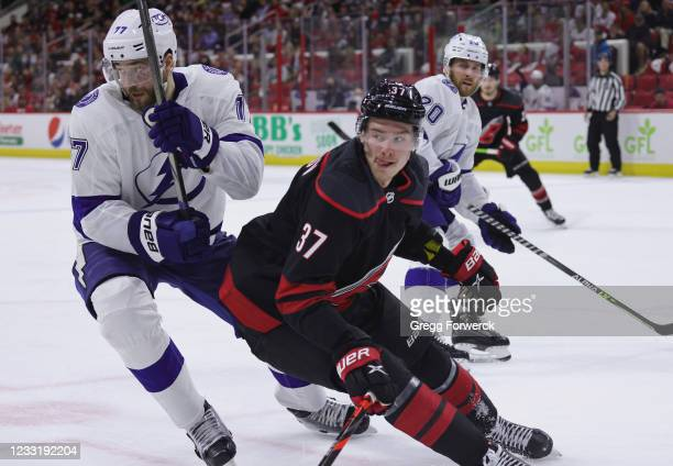 Andrei Svechnikov of the Carolina Hurricanes and Victor Hedman of the Tampa Bay Lightning battle for position in Game One of the Second Round of the...
