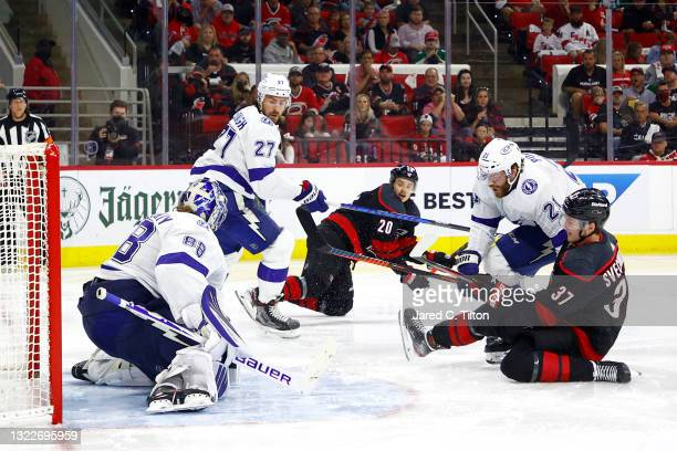 Andrei Svechnikov of the Carolina Hurricanes attempts a shot against Andrei Vasilevskiy of the Tampa Bay Lightning during the third period in Game...