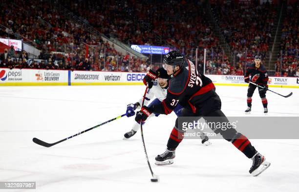 Andrei Svechnikov of the Carolina Hurricanes attempts a shot during the third period in Game Five of the Second Round of the 2021 Stanley Cup...