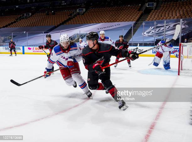 Andrei Svechnikov of the Carolina Hurricanes battles against Jacob Trouba of the New York Rangers during the first period in Game One of the Eastern...