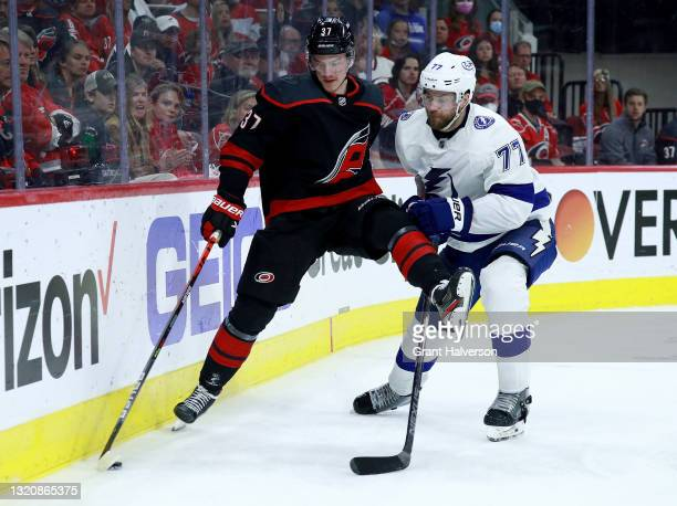 Andrei Svechnikov of the Carolina Hurricanes battles Victor Hedman of the Tampa Bay Lightning for the puck during the third period in Game One of the...