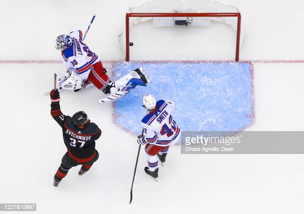 Andrei Svechnikov of the Carolina Hurricanes celebrates a goal by teammate Jaccob Slavin against Henrik Lundqvist of the New York Rangers during the...
