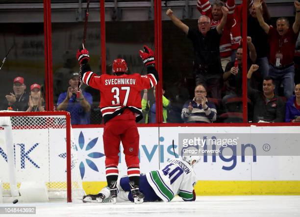 Andrei Svechnikov of the Carolina Hurricanes celebrates after scoring a goal during an NHL game against the Vancouver Canucks on October 9 2018 at...